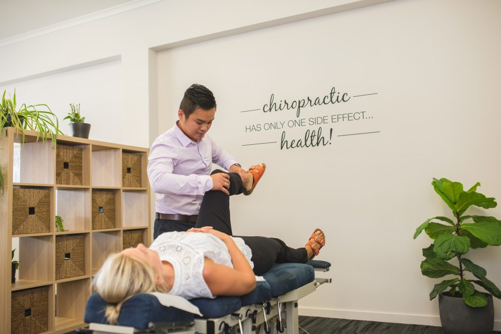 Dr. Duy treating patient at Total Health Chiropractic Rockhampton