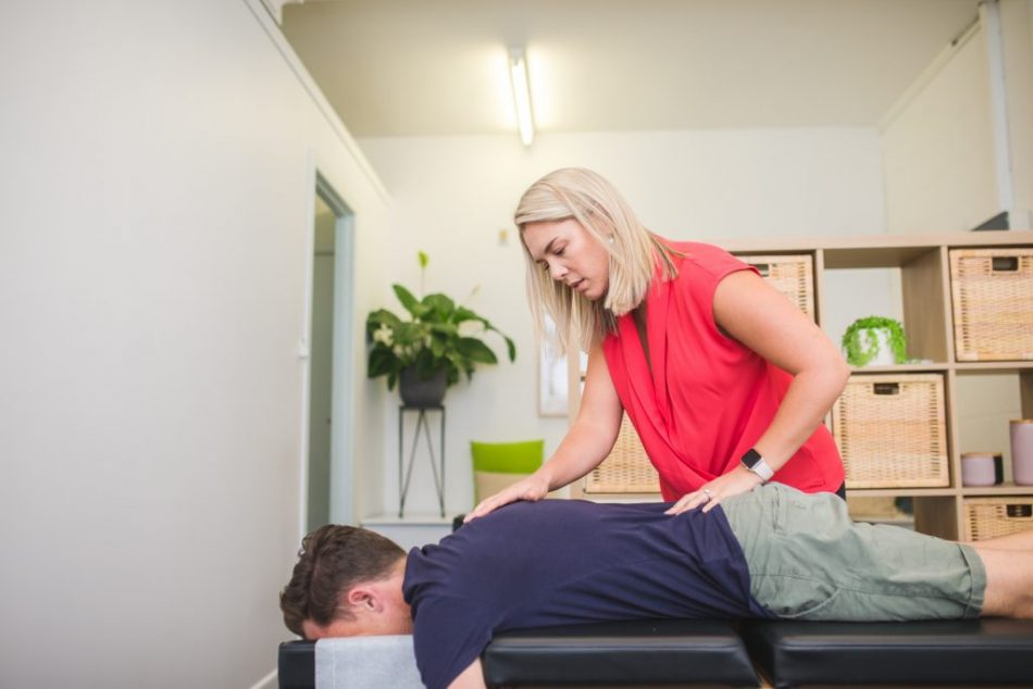 Dr. Lucy (Chiropractor) treating patient at Total Health Chiropractic Torquay