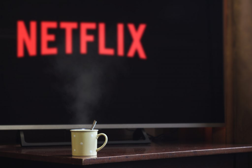 close up of television screen displaying netflix icon