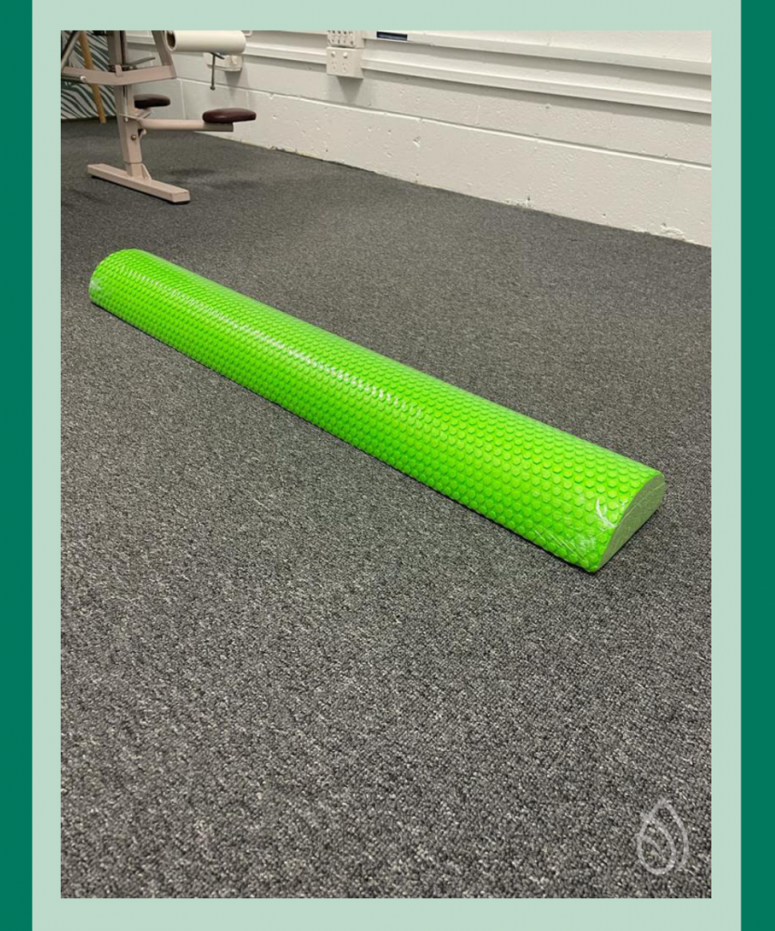 product image of a posture pole laying on the ground