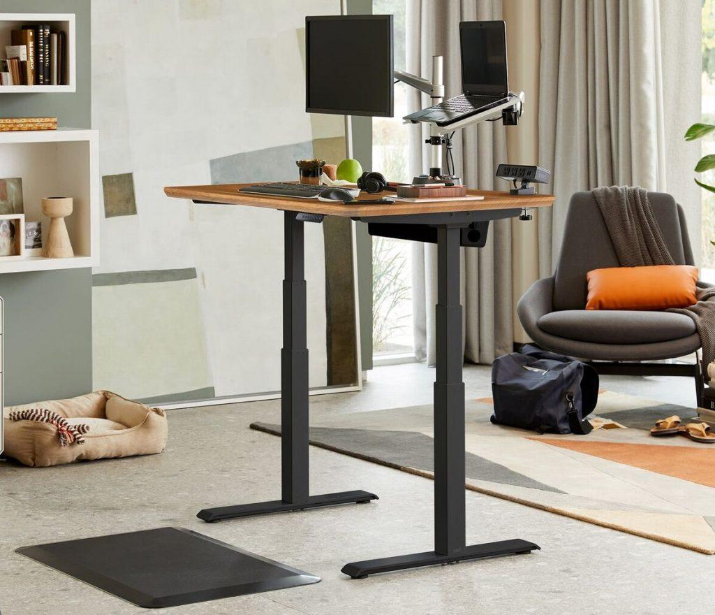 Varidesk electric standing desk stock photo