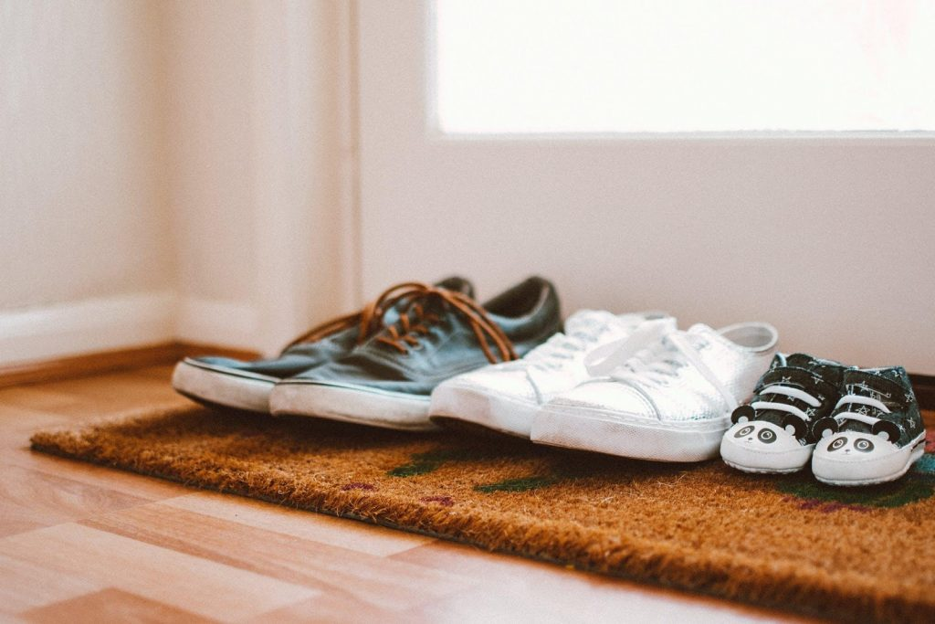 shoes lined up on a doormat