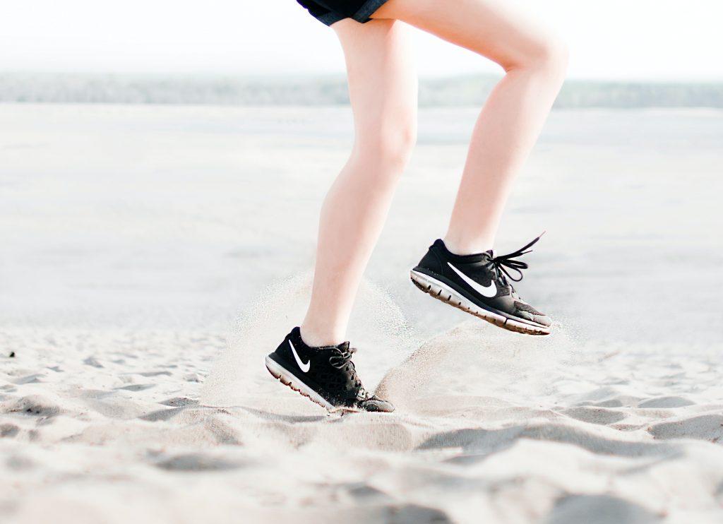 lower body shot of female running on sand