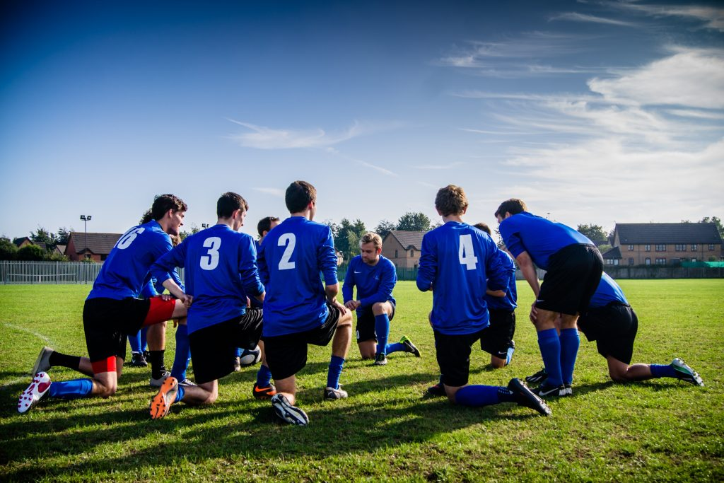 sporting team huddle before soccer game
