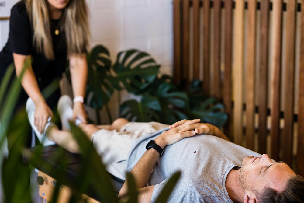 Chiropractor performing adjustment on patient
