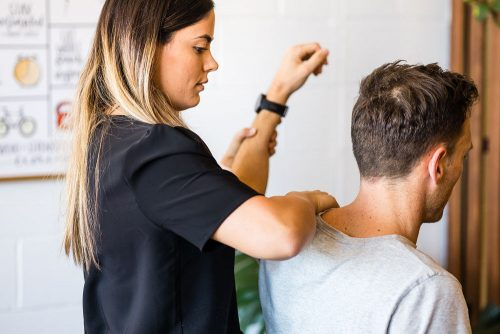 Frankston City Chiropractor performing shoulder assessment on patient