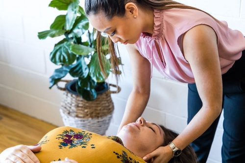 Rye Chiropractor performing cervical adjustment on female patient