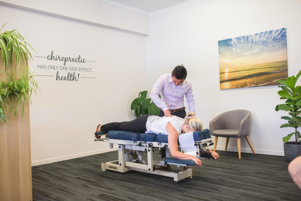 Norman Garden Chiropractor providing Chiropractic care to female patient