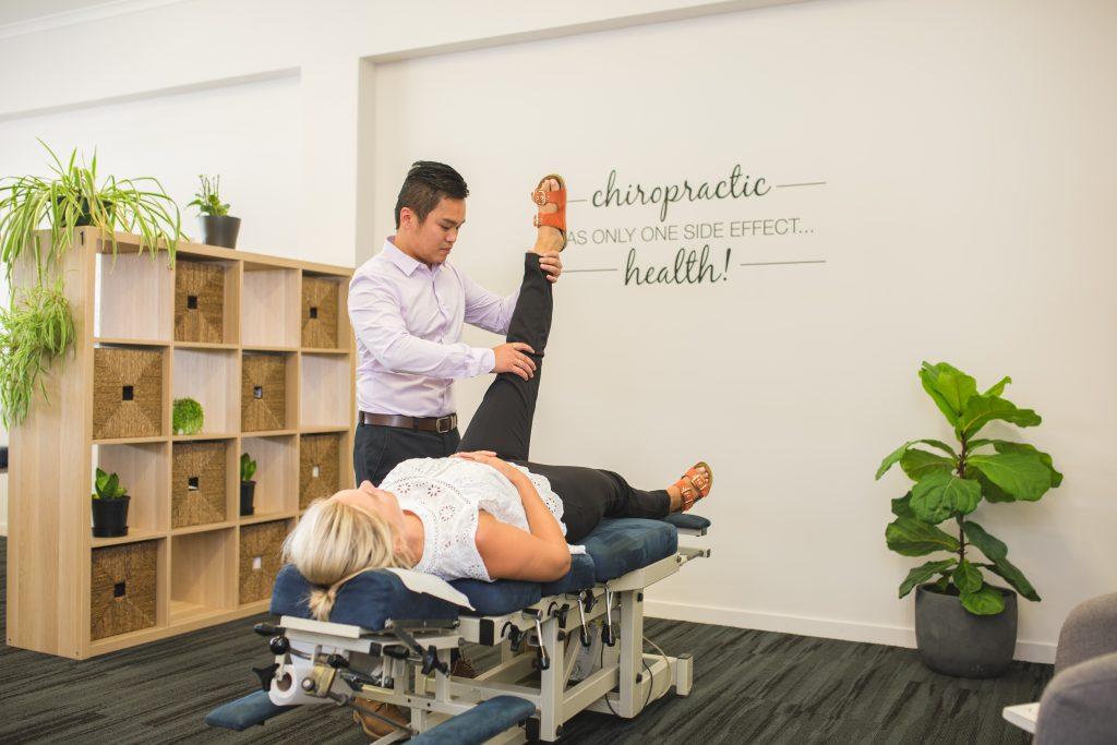 Rockhampton Chiropractor performing leg length assessment on female patient