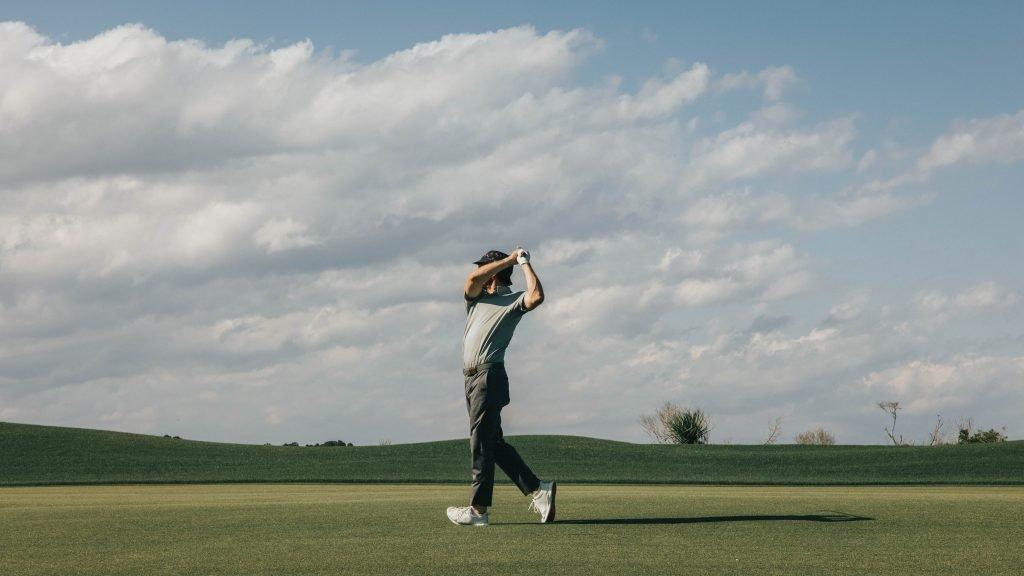 male golfer swinging golf club