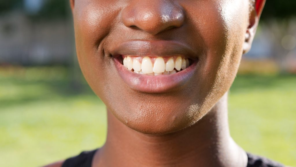 Image of lower half of woman's face, smiling