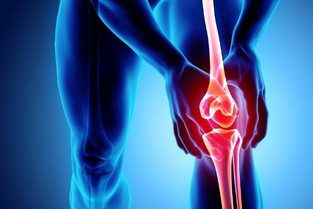 Image of male clutching knee in pain