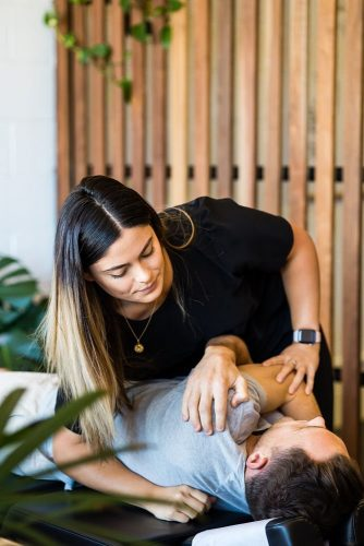 Paraparap Chiropractor performing adjustment on male patient