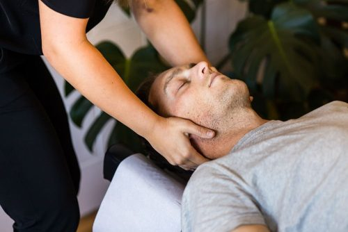 Freshwater Creek Chiropractor performing neck adjustment on male patient