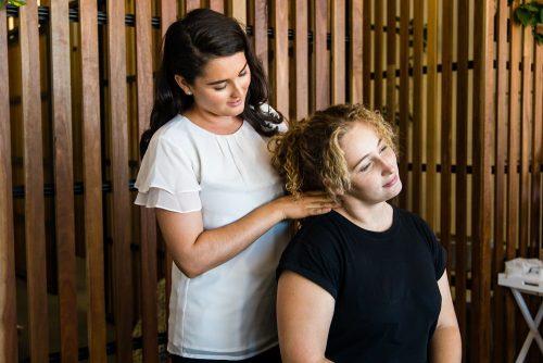 Fairhaven Chiropractor performing neck adjustment on female patient