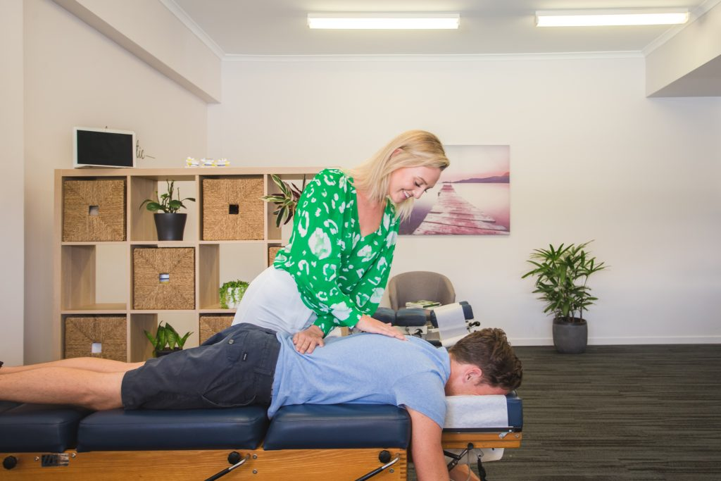 Pacific Heights Chiropractor performing back adjustment on male patient